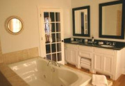 blue-bath-Boutique hotel Inn sale Fredericksburg TX 300x199