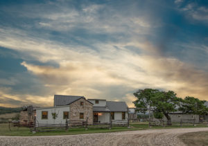 ranch land with pioneer rock home